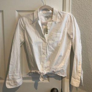 Classic white button shirt.